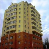 Окрашеный и утепленный фасад